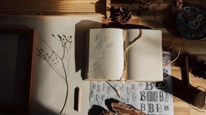 poetry, a desk featuring a notebook, stationery, and plants