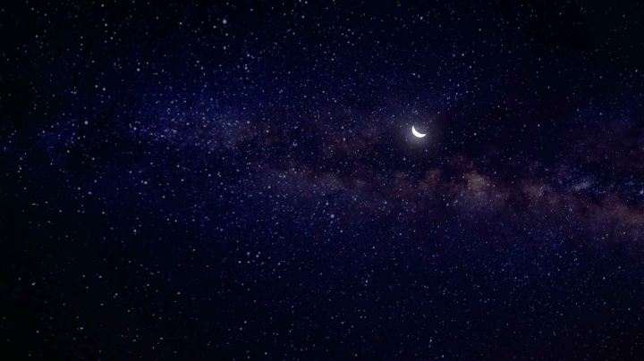 starry night sky with a crescent moon